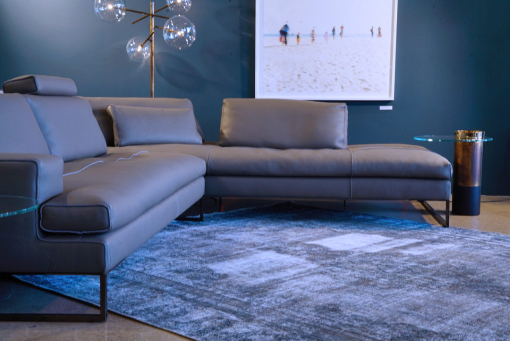 blue-grey-vintage-rug-under-modern-sofa